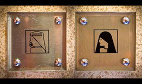 Bathroom signs in Burj Al-Arab. Flickr/Asim Bharwani. Some rights reserved.