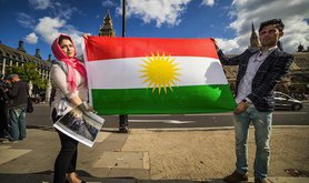 Protesters in London hold up the Kurdish flag. Demotix/Guy Corbishly. ALl rights reserved.