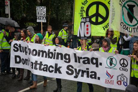Anti-war campaigners call for an end to bombing Iraq, 2014.