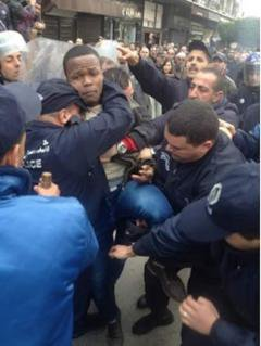5 A young activist being tackled by riot police in Algiers – Source- Adlène Meddi _0.jpg