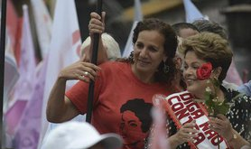 Dilma Rousseff throws flowers to supporters, 2014. Demotix/Fabio Teixeira. All rights reserved.