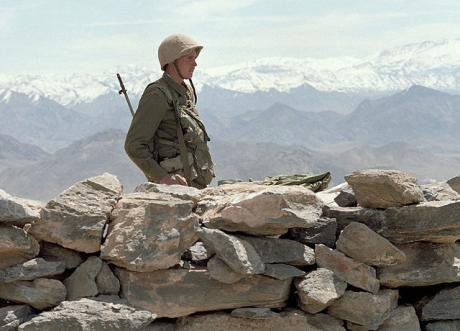 A Soviet soldier stands guard on an Afghan road. 15 May 1988.