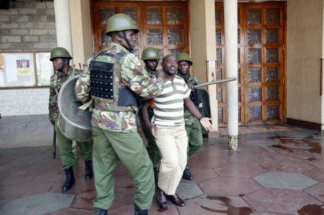 Protesters confront police over Terror Law passed by Kenyan Parliament, Dec. 2014