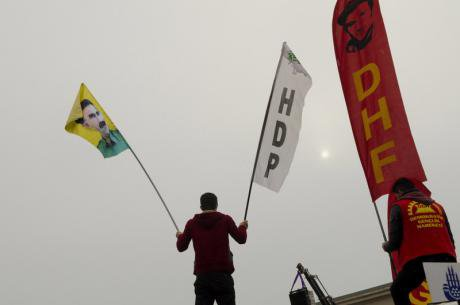Alevi protestor at compulsory religious classes with PKK and HDP flags, 2015.