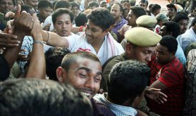 Indian crowd celebrate newly elected politicians in Nagaon, 2013.