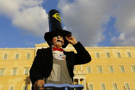 Performer dressed as a banker representing IMF,ECB and Eurogroup at the protest.