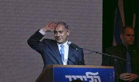 Benyamin Netanyahu addresses a crowd of supporters after his surprise victory.