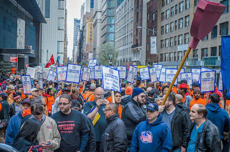 Stand up against income inequality protesters march on May Day