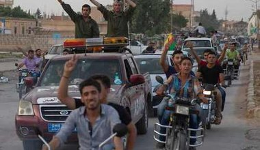 Kurd fighters and residents celebrate capture of Mabrouka from ISIS. Björn Kietzmann/Demotix. All rights reserved.