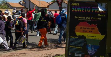 """Giving homophobia a red card,"" reads a poster for the 2012 Soweto Pride march."