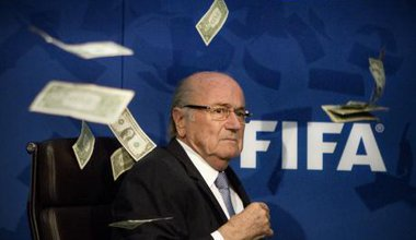 Seb Blatter showered with cash at a press conference in Zurich, July 2015.