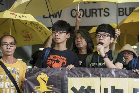 Joshua Wong appears in court. Demotix/Jayne Russell. All rights reserved.