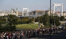Migrants bound for Germany walk through the streets of Budapest. Demotix/Beata Zawrzel. All rights reserved.