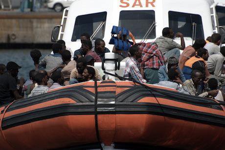 Refugees at the port of Catania. Demotix/Salvatore Allegra. All rights reserved.