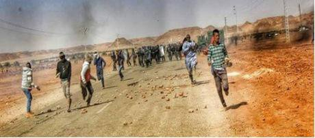 8 Unseen before – people of the Sahara throwing stones and running from police forces Source- Ain Salah Sun & Power_0.jpg