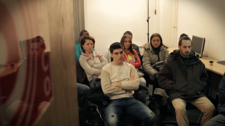 A group of Bosnia youth sit in an office during a labour presentation