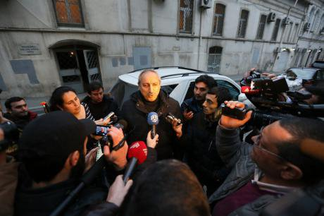 Lawyer Fuad Aghayev talks to the press after the sentencing of his client, journalist Rauf Mirkadyrov, to 6 years' imprisonment
