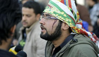 Wounded man talks to media after suicide attack hits a procession of Shiite mourners in Kabul City, 2013.