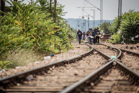 A group of migrants walk on the last leg of their crossing from Greece. Stephen Ryan:Flickr. Some rights reserved.jpg