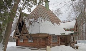 A wooden Russian teremok in winter.