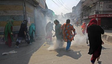 A women's protest about braid chopping in Kashmir, India, is dispersed by police using tear gas. October 2017. Image Faisal Khan_Zuma Press_PA Images.jpg