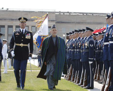 Afghan President Hamid Karzai walks past a regiment of US troops in dress uniform outside the Pentagon.