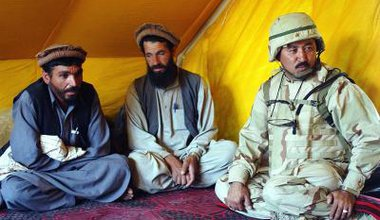 Afghan_residents_and_Afghan_interpreter_in_2002.jpg