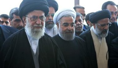 Ali_Khamenei_and_Hassan_Rouhani_in_funeral_of_Abbas_Vaez-Tabasi.jpeg