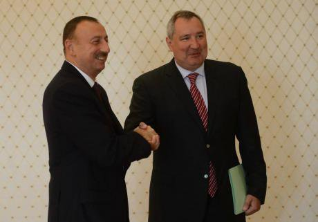 Dmitry Rogozin shakes hands with Azerbaijan's president Ilham Aliyev in September 2014.