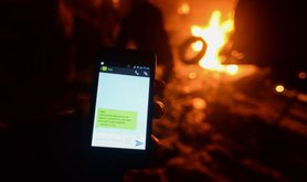 A Ukrainian protester receives an anonymous text noting they are 'registered in mass disorder'