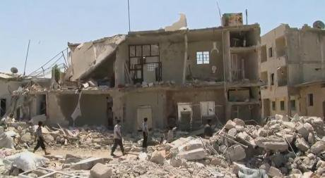 Azaz_Syria_during_the_Syrian_Civil_War_Missing_front_of_House.jpg