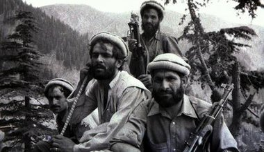 Black and white photo of several armed Mujahideen
