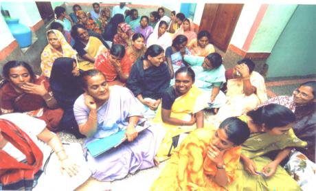 20 or so women sitting in a room