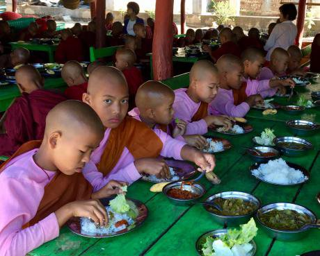 Buddhist pupils have lunch in a monastic school's canteen in Shan State, Myanmar.
