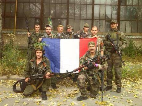 French volunteers in Donbass. Nikola Petrovic stands front row right He has a mustache and an assault rifle.