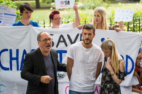 Rev Patrick Mahoney (left) alongside the parents of Charlie Gard.