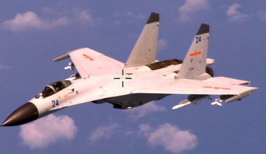 An armed Chinese Shenyang J-11 fighter jet flies near a U.S. Navy Boeing P-8A Poseidon patrol aircraft over the South China Sea about 220 km east of Hainan Island in international airspace. 19 August 2014