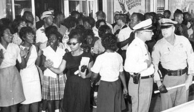 Civil_rights_demonstration_in_front_of_a_segregated_theater_Tallahassee,_Florida_(6847006931).jpg