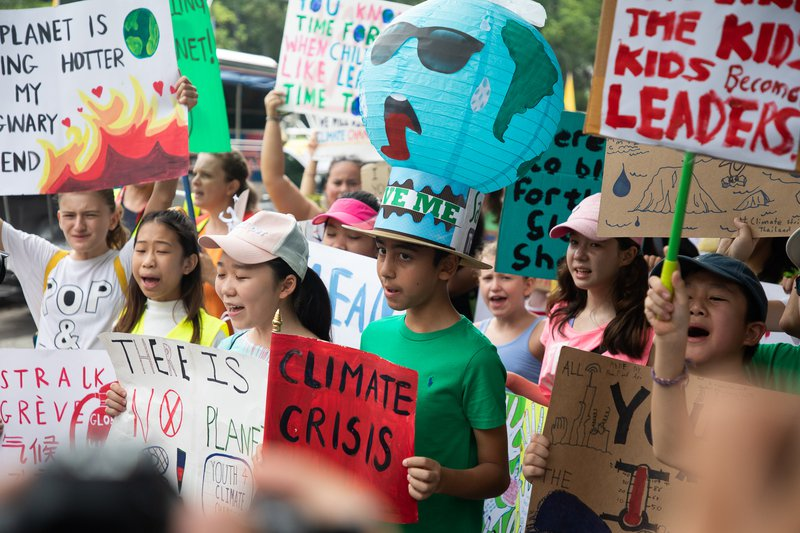 Schoolchildren taking part in the global climate strike in Bangkok, 2019.