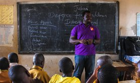 Defence for Children International-Sierra Leone staff member speaks to classroom of children in Adonkia community in Western Area- They do school out reach to talk about child rights, child participation in school governance, sexual gender based violence