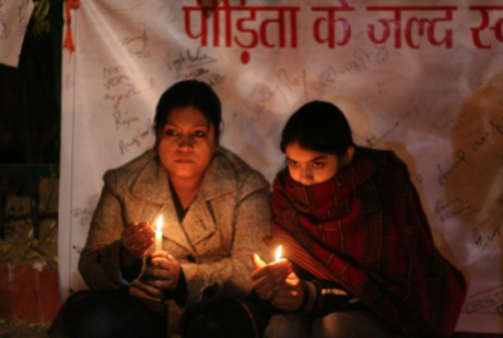 Candlelit vigil for a child victim of a gang rape, Delhi, India 2012.
