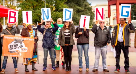 Activists demonstrate in support of a binding treaty on transnational corporations.