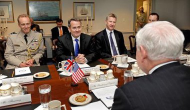 British Defense Minister Liam Fox (3rd from right) meets with Secretary of Defense Robert M. Gates (right) in the Pentagon.