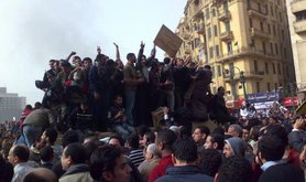 Protesters in Egypt's Tahrir Square mob an army vehicle. Such scenes made a deep impression on Russian officials.