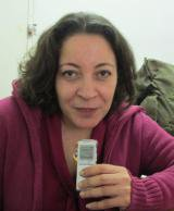 Woman with dictaphone smiles at camera