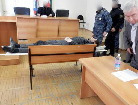 Edigov lying on a stretcher in court following his hunger strike.