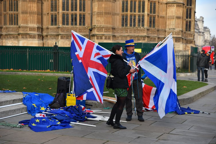 EU and Union flags are waved outside the Parliament to protest against Brexit on November 27, 2018