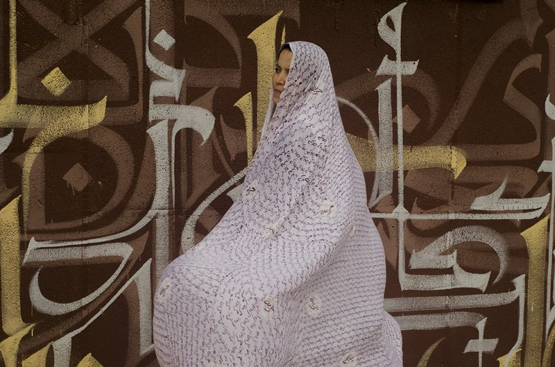 Figure 3 The Algerian artist Souad Douibi wearing a veil with an Arabic transcription of Freedom.jpg