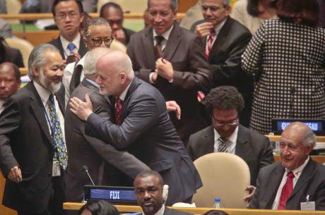 Fiji U.N. Ambassador Peter Thomson, center, receives congratulations from U.N. diplomats on his election as the new U.N. General Assembly president.jpg