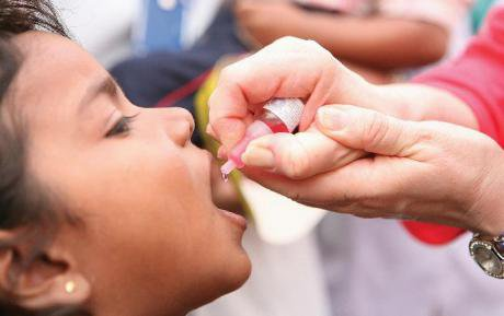 Child receiving a polio shot in Pakistan.